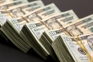 Dollar trims annual gains in low volatility year, more action seen in 2020