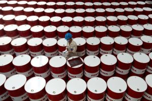 Oil hovers near three-month high on trade optimism, supply cuts
