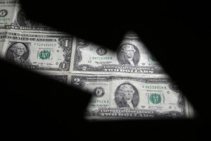 U.S. dollar gains slightly after declining for two weeks