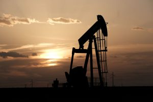 Oil edges up on tighter supply, but demand worries limit gains